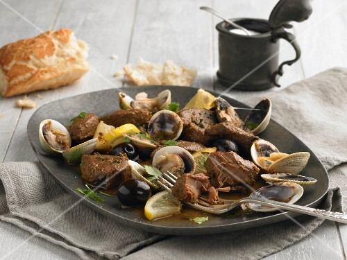 Pork with mussels, olives, lemons and coriander