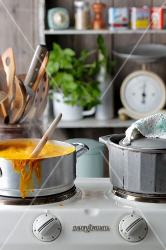Soup simmering in saucepan on cooker
