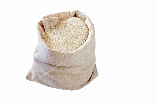 White rice in a linen sack