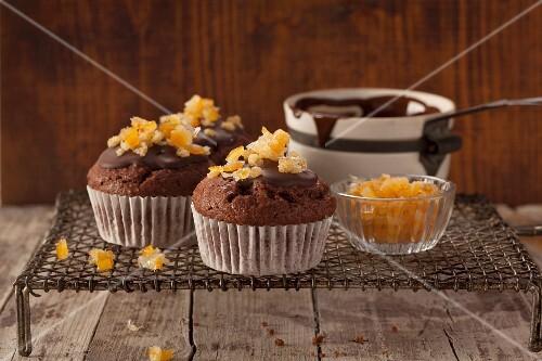 Chocolate muffins with candied orange zest