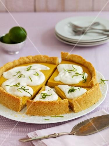 Vegan mango and marzipan cake with yogurt cream and lime zest