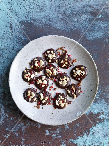 Chocolate bites with almonds and sugar sprinkles