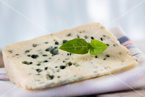 A slice of Roquefort Marival (French blue cheese)