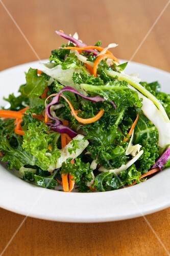 Kale salad with strips of carrot and red cabbage