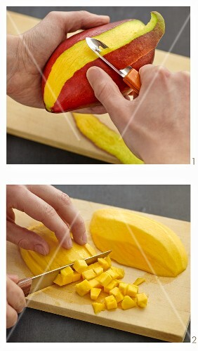 A mango being peeled and diced