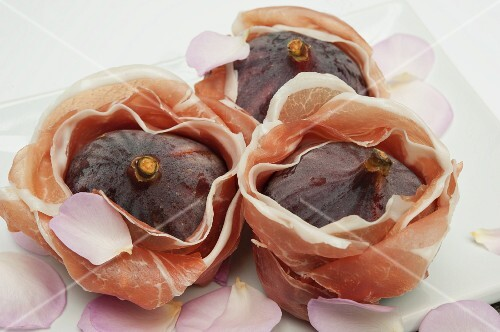 Prosciutto Wrapped Figs on White Platter