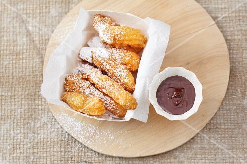 Churros with chocolate for dipping