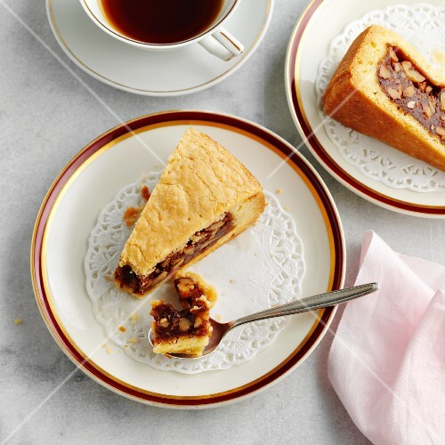 Two slices of Graubünden nut pastry and a cup of coffee