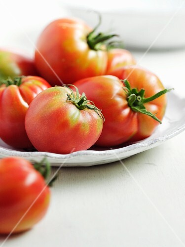 Tomatoes on a white plate