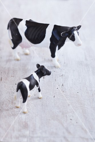 A plastic toy cow and a calf