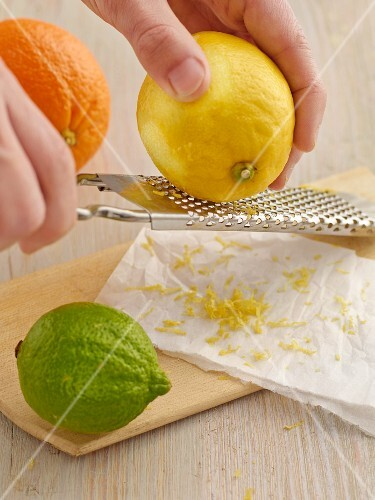 A lemon being grated