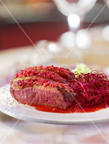 Roast duck breast with beetroot straw