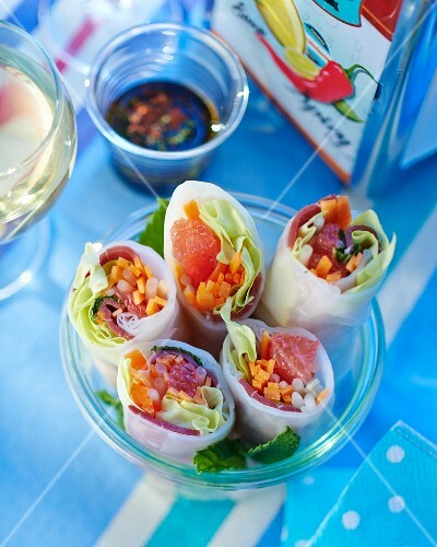 Rice paper rolls filled with duck breast, vegetables and grapefruit