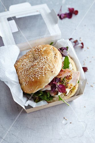 A bagel with trout and daikon cress