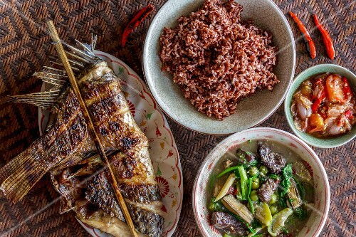Grilled stuffed fish, beef and vegetable curry and a tomato and chilli dip, Laos