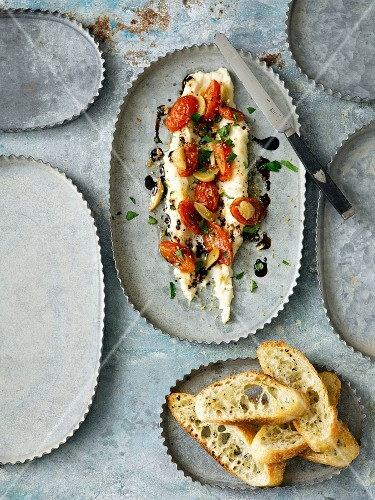 White bean puree with roasted pear tomatoes, garlic, balsamic vinegar and parsley served with toasted baguette.
