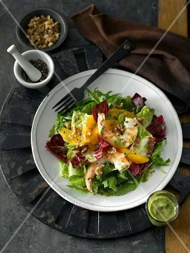 Winter salad with radicchio, shrimps, oranges, pepper and a Dijon mustard dressing