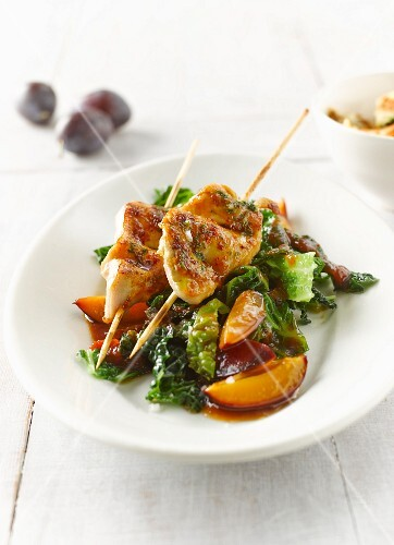 Chicken breast skewers with savoy cabbage, plums, bacon, shredded herb pancake and tomato sauce