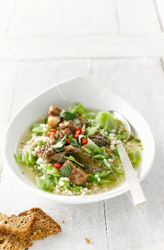 Barley stew with white cabbage, beef, chilli peppers and parsley