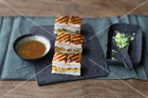 Oshi sushi with yakitori chicken and a daikon dip