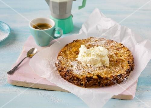 A small Italian apple tart with cream