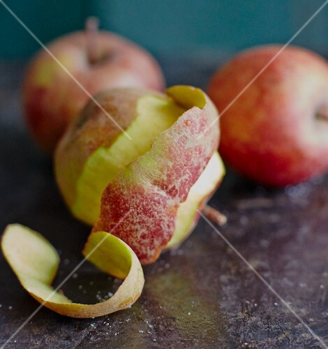 An arrangement of apples with one half peeled