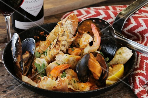 Fisherman's stew with saffron white wine, cream and fresh fish. Langoustines, bugs, mussels, prawns, scallops, dorado and jewfish. Can be substituted for any fresh fish.