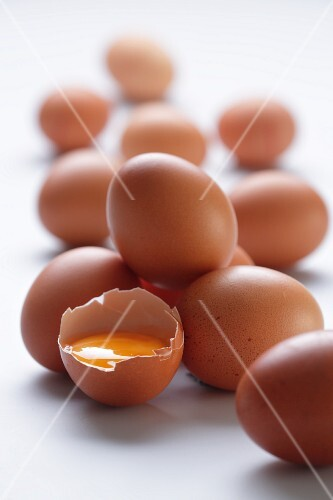 Brown eggs, one cracked open