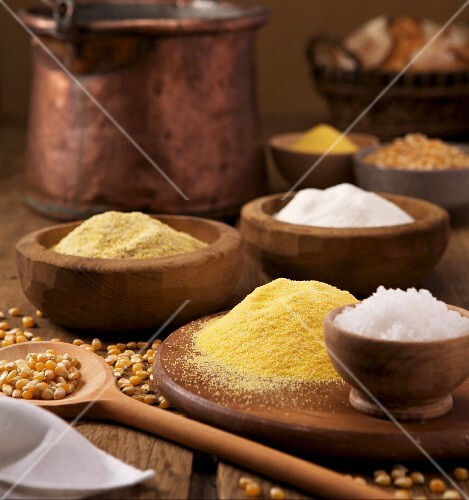 An arrangement of polenta, salt and corn kernels