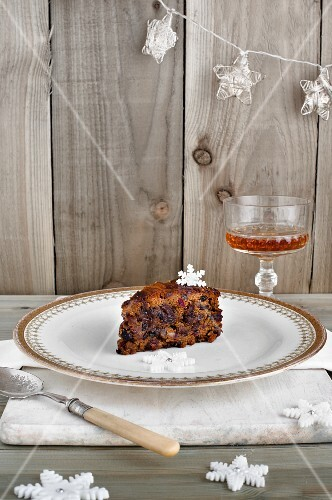 A slice of Christmas fruit cake and a glass of sherry