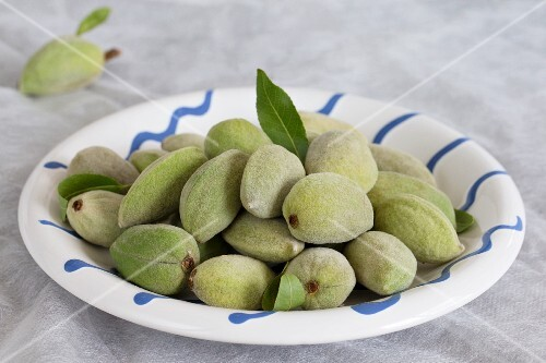 A plate of whole, fresh almonds
