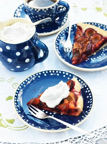Two slices of damson cake with whipped cream