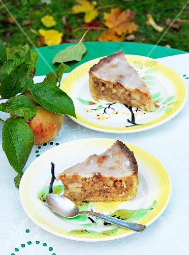 Two slices of layered apple cake on a garden table