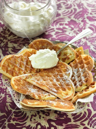Crispy waffles with icing sugar and whipped cream