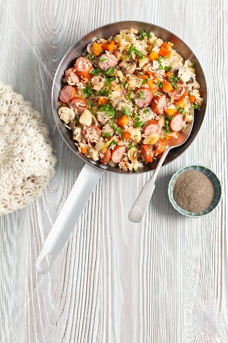 Fried rice with sausage and carrots