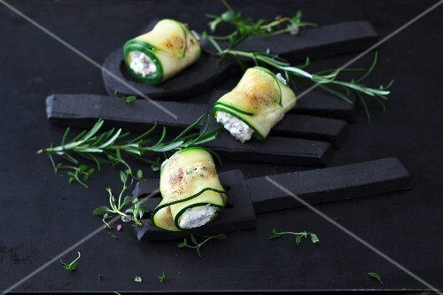 Courgette rolls with goats cheese cooked on a hot stone