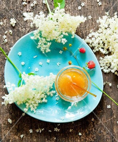 Elderflower honey, elderflowers and wild strawberries
