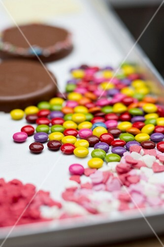 Colourful chocolate beans and sugar hearts for decorating