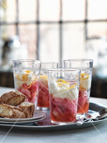 Rhubarb compote with mascarpone cream and lemon zest in glasses