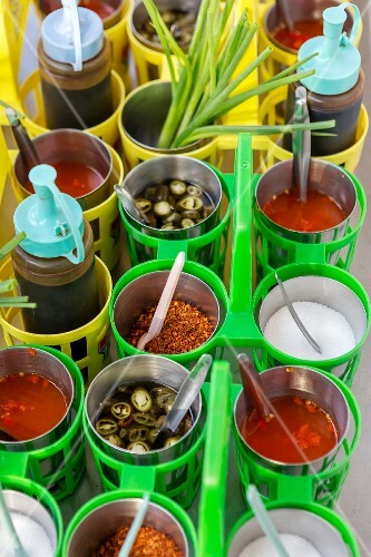Various sauces and spices in a restaurant (Thailand)