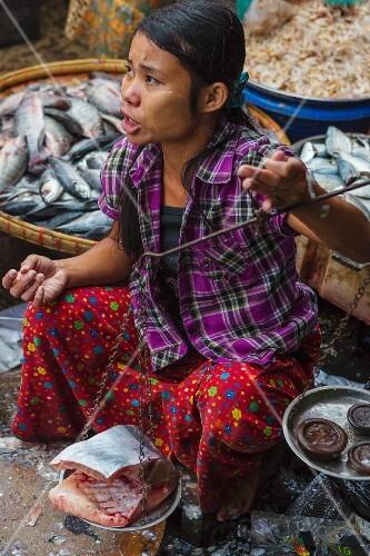 A fish seller at a market (Yangon, Myanmar)