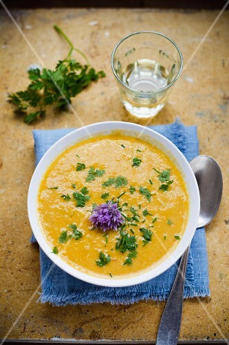Carrot soup with chervil and chive flowers