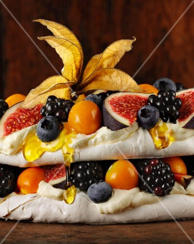 Pavlova with fruit, berries and honey