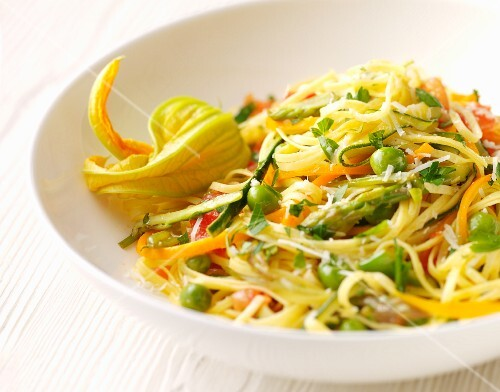 Egg pasta with summer vegetables and courgette flowers