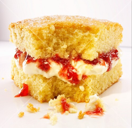 A slice of Victoria Sponge Cake with a bite take out