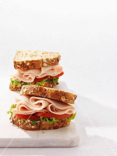 Chicken, tomato and lettuce sandwiches