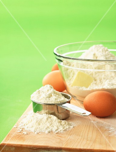 Flour, butter and eggs on a chopping board