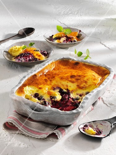 Blueberry gratin in a rustic baking dish
