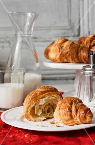 Croissants, milk and a sugar shaker