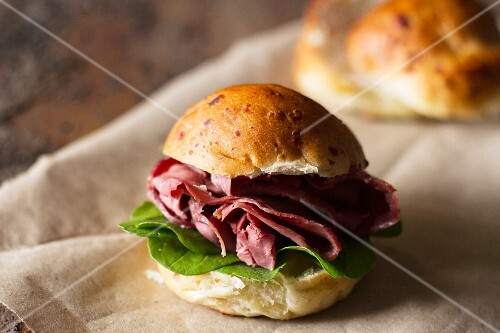 A spinach and pastrami sandwich